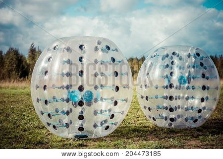 Bumper-balls For Soccer Playing On A Green Lawn, A New Funsport