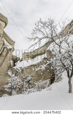 Unique Geological Rock Formations Under Snow In Cappadocia, Turkey.