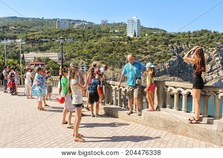 Yalta, Crimea - 11 July, People take pictures at the fence, 11 July, 2017. Small Castle Lastochkino Nest and its surroundings.