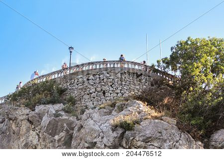 Yalta, Crimea - 11 July, Fence on the stone wall, 11 July, 2017. Small Castle Lastochkino Nest and its surroundings.