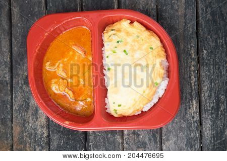Chicken panang curry with rice and omelet in the box for take away