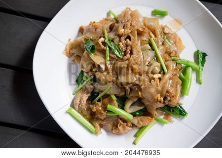 Fired Thin Noodles In Sweet Soy Sauce With Pork