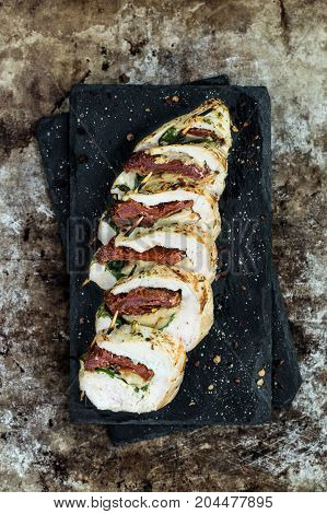 Chicken breast stuffed with spinach, cheese and sun-dried tomatoes