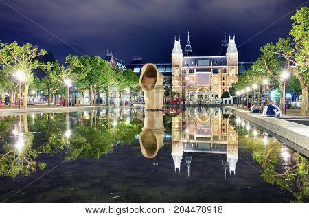 Amsterdam Netherlands - August 15 2017: The Rijksmuseum Amsterdam museum area with the words I AMSTERDAM in Amsterdam Netherlands.
