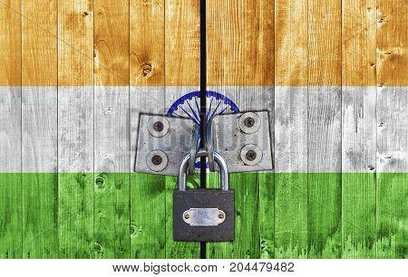 India flag on door with padlock close