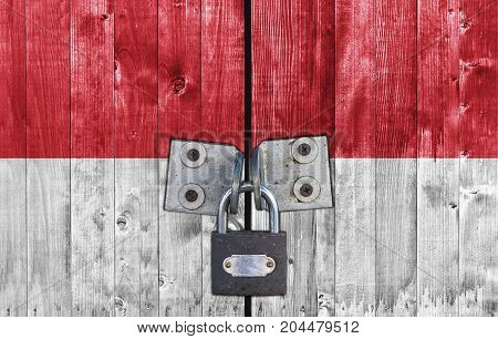 Indonesia flag on door with padlock close