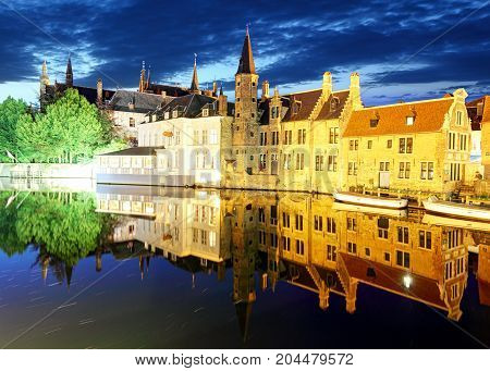 Bruges - Night historic medieval buildings along a canal Belgium
