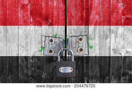 Iraq flag on door with padlock close