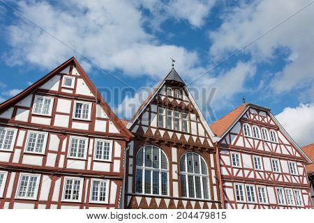 Historic Half Timbered Houses With Blue Sky And Clouds
