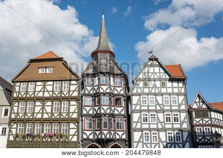 Half Timbered Houses With Blue Sky And Clouds In The Small German Town Fritzlar