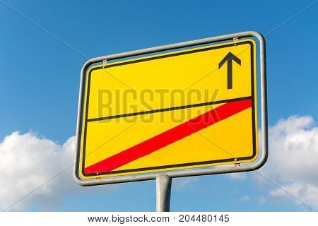 Blank Yellow City Sign With Arrow And Red Struck Through Line In The Street