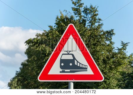 A Triangular Street Sign For Train Tracks