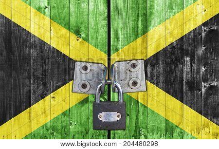 Jamaica flag on door with padlock close