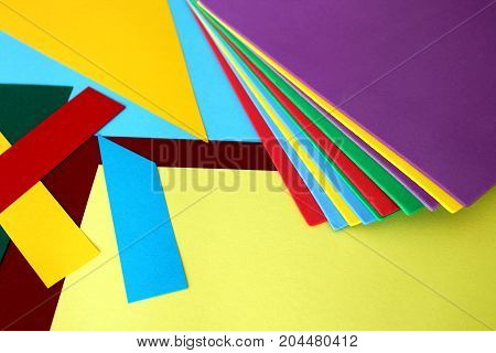 Colored sheets of paper thrown in disorder Playing colors