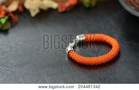 Bead Crochet Bracelet Orange Color On A Dark Background