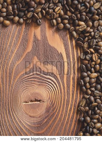 Multiply coffee beans on the wooden table. Top view