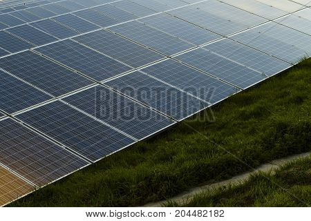Solar Panels Row Installed In Normandy, France. Close Up. Solar Energy, Modern Technology Of Electri