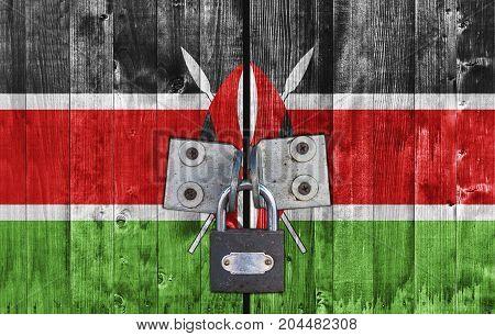 Kenya flag on door with padlock close