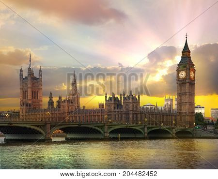 London at sunset. Beautiful idealistic sunset behind the Big Ben and Houses of Parliament