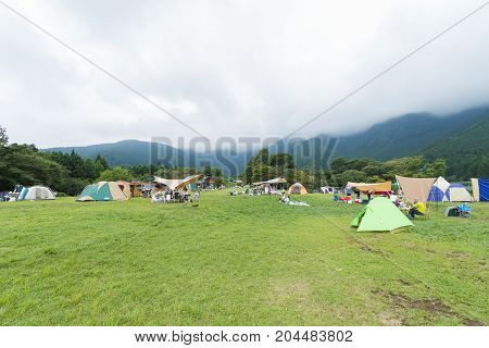 Yamanashi Prefecture Japan - August 19 2017:Lake and mountain view Camping tents in Yamanashi Prefecture Japan .