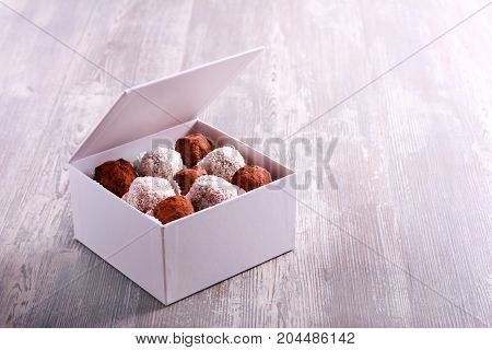 Homemade truffle and fruit candies in a box
