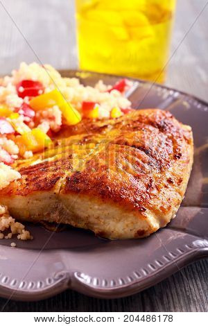 Bighead carp fish fried and vegetable couscous on plate
