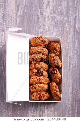 Muesli cookies in paper box top view