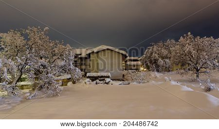 Twilight in the small mountain city filled-up by snow. Bansko Bulgaria.