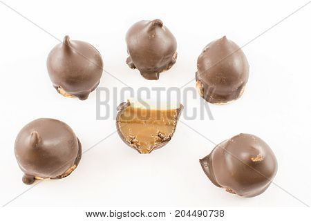 Bow of whole milk confectionery cones and one cut in half in half. White background.