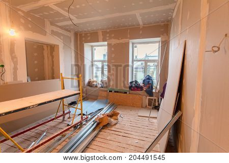 Material for repairs in an apartment is under construction remodeling rebuilding and renovation. Making walls from gypsum plasterboard or drywall.