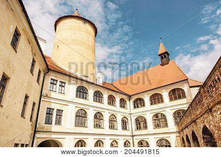 Courtyard of Veveri castle Czech republic. Ancient architecture. Travel destination. Yellow photo filter.