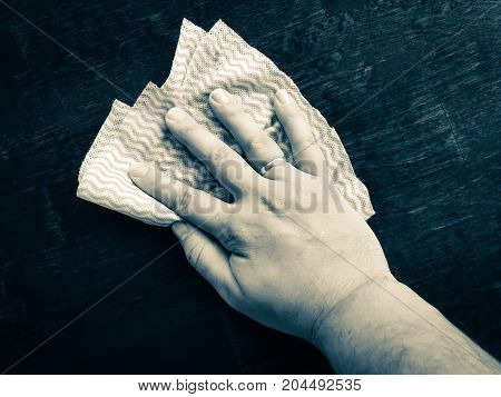 close up photo of hand and wipe.