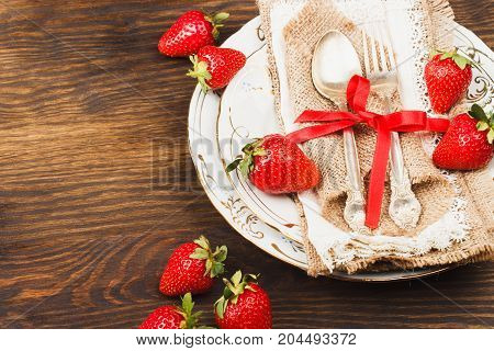 Tableware And Silverware With Red Strawberries