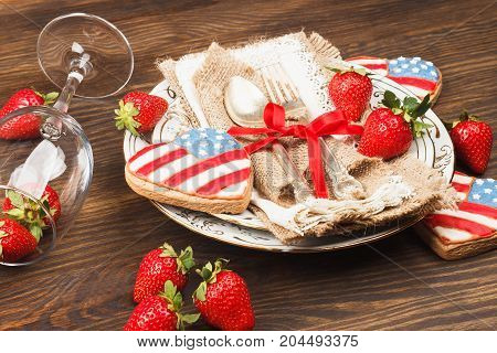 Tableware And Silverware With Strawberry And Cookies With American Flag