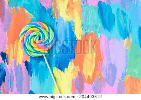 lollipop candies on a colourful wooden background