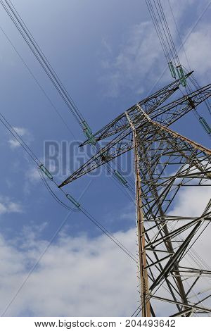 Pylon of high voltage line and blue sky background