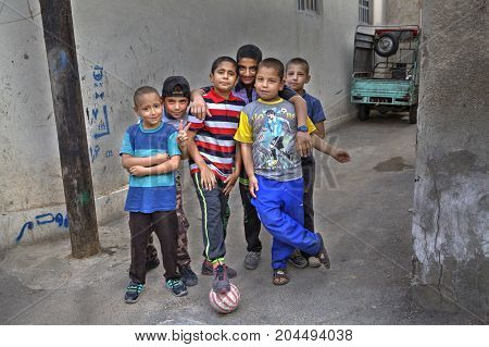Fars Province Shiraz Iran - 18 april 2017: Street children posing for a photograph a group portrait of the yard football team.