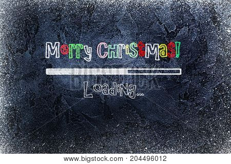 Black chalkboard with loading bar and Merry Christmas drawn on it. Happy new year greeting card. Space for text