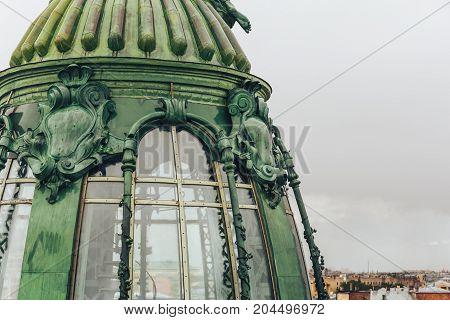 Tower of House of Singer or Zinger on Nevsky Prospekt, St. Petersbyrg, Russia. Old bronze tower