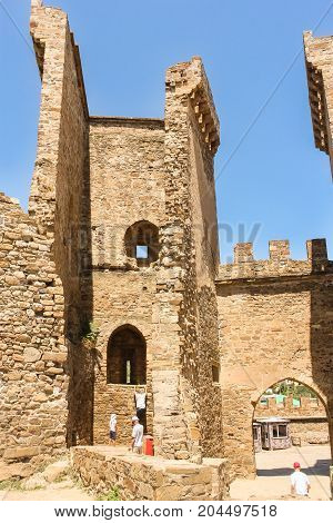 Sudak, Crimea - 12 July, Tourists visiting the ancient fortress, 12 July, 2017. Genoese ancient fortress near the city of Sudak.