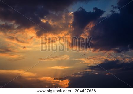Sky and clouds at sunset as background, toned