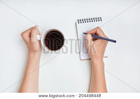 Hand Writing. Woman Writes In Notebook With Pen, Enjoys Good Morning And Hot Tea. Writing Concept. F
