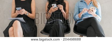 Group adult hipsters friends sitting sofa using modern gadgets. Business startup friendship teamwork concept. Creative people working sale project. Coworking process office studio. Panoramic banner.