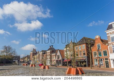GRONINGEN, NETHERLANDS - APRIL 02, 2017: Old houses at the new Damsterplein square in Groningen Holland
