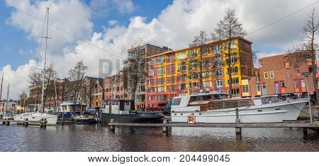 GRONINGEN, NETHERLANDS - APRIL 02, 2017: Panorama of the colorful east harbor in Groningen Netherlands