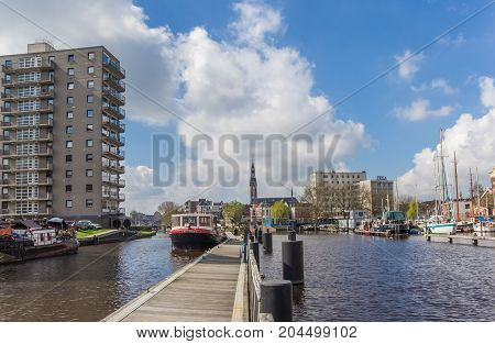 GRONINGEN, NETHERLANDS - APRIL 02, 2017: Wooden jetty in the east harbor of Groningen Netherlands