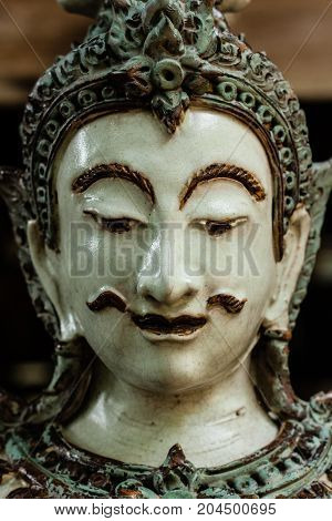 Face of Thai male angel traditional style ceramc sculpture