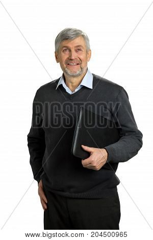 Smiling mature man holding folder. Cheerrful senior man standing with folder on white background and looking upwards.