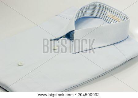 shirt collar of light blue shirt isolate on white