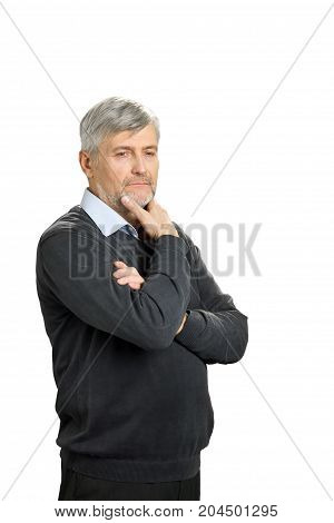 Thoughtful mature man on white background. Thoughtful senior man in formalwear holding hand on chin and looking away, white background. Pensive elderly man isolated on white background.